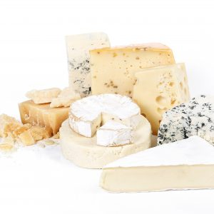 Various cheeses on a white background